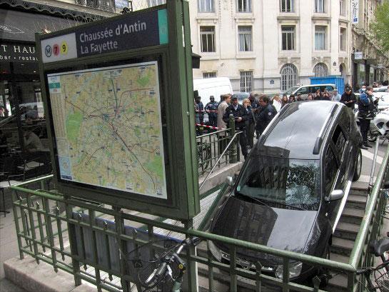 man drives car down paris metro stairs. Black Bedroom Furniture Sets. Home Design Ideas