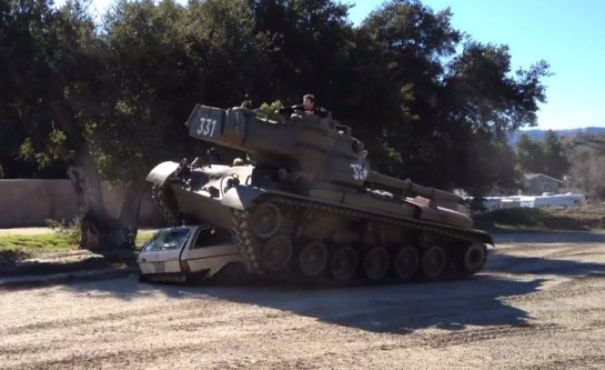 Arnold in Tank 545x333 at Still Got it: Arnie Crushes a Car with His Tank