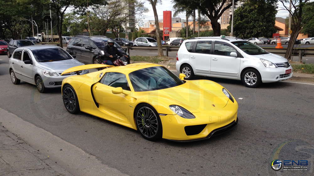 racing yellow porsche 918 spotted in brazil. Black Bedroom Furniture Sets. Home Design Ideas