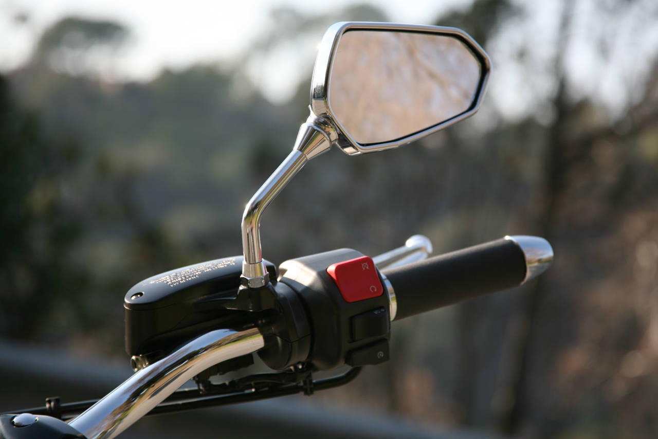 extra mirror motorcycle threatening vigilant arrival due effect urged motorcyclists past into