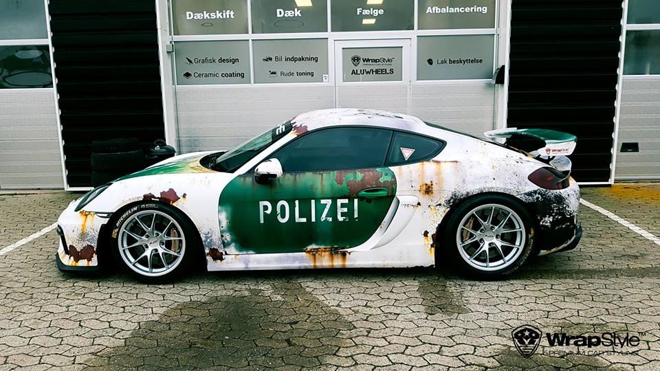 Porsche Cayman In Rusty Polizei Wrap