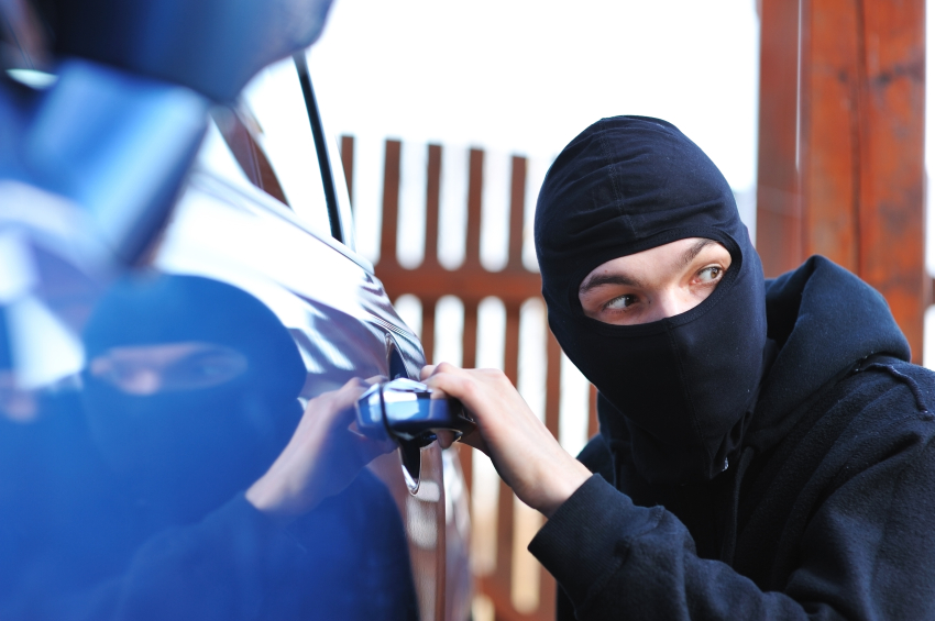 thief stealing a car at How to prevent your car from being stolen?