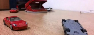 Sesto Elemento vs F12 Berlinetta in Stop Motion Race!
