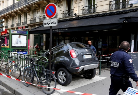 car in metro 3 at Man drives car down Paris Metro stairs