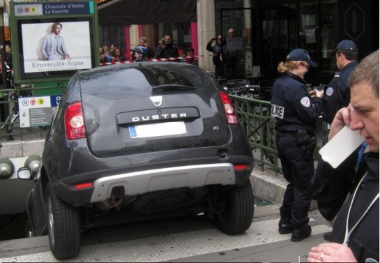 car in metro 5 at Man drives car down Paris Metro stairs
