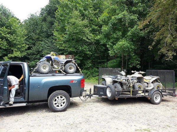 pickup towing atvs 600x450 at Things You Should Know Before Towing with Your Pickup Truck