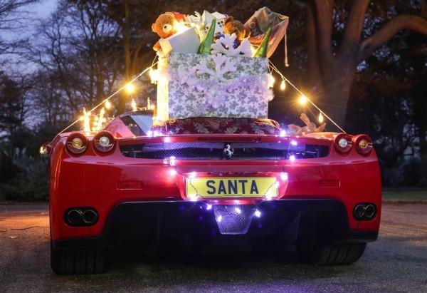 santa ferrari enzo 1 600x411 at Rich Santa Has a Ferrari Enzo Sleigh!