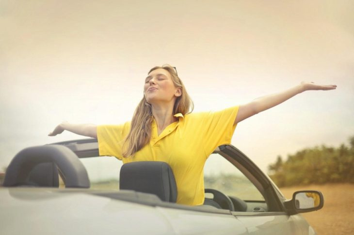 yellow dress girl on convertible 730x486 at 6+ Things to Consider When Buying a Used Car Warranty 2019