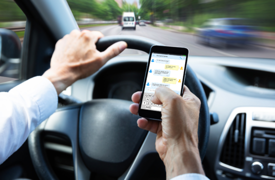 drive and text 550x360 at How Dangerous is Texting and Driving?