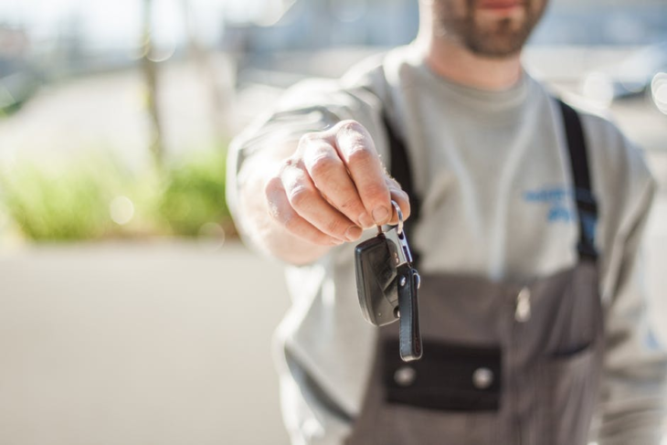 man with car key 730x487 at When Should You Sell Your Car? Signs You Need to Do It Now