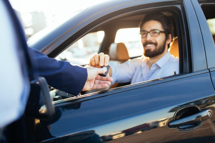 man with a car key 730x487 at 5 Expert Tips to Get a Good Deal On a Used Car