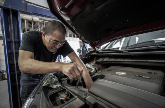 man working on a car 550x360 at 9 Regular Car Maintenance Tips to Keep Your Vehicle in Good Shape
