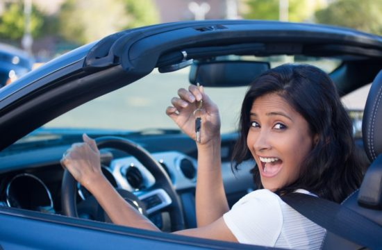 happy girl inside car 550x360 at When Is the Best Time to Buy a Car? A Simple Guide
