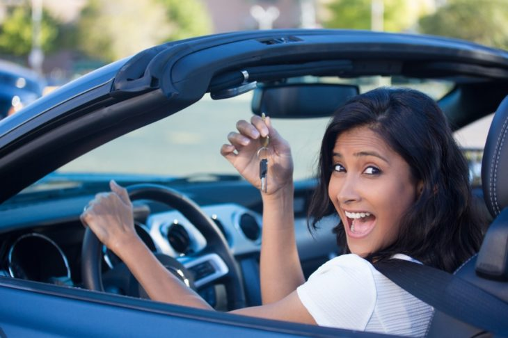happy girl inside car 730x486 at When Is the Best Time to Buy a Car? A Simple Guide