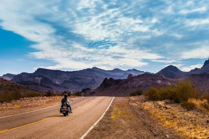 motorcycle on road 730x486 at 4 Tips for Your First Motorcycle Road Trip